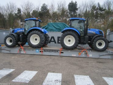 Tractor lashed to flat rack